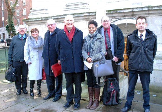 Canon Ian (centre) with Church Housing Trust staff and other trustees