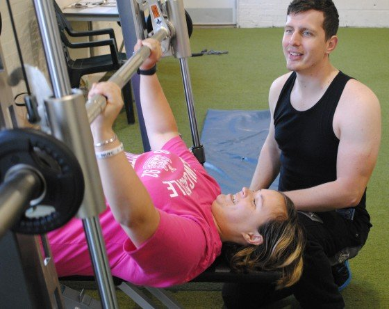 Swale Your Way member Sharon practises weights with Andrew
