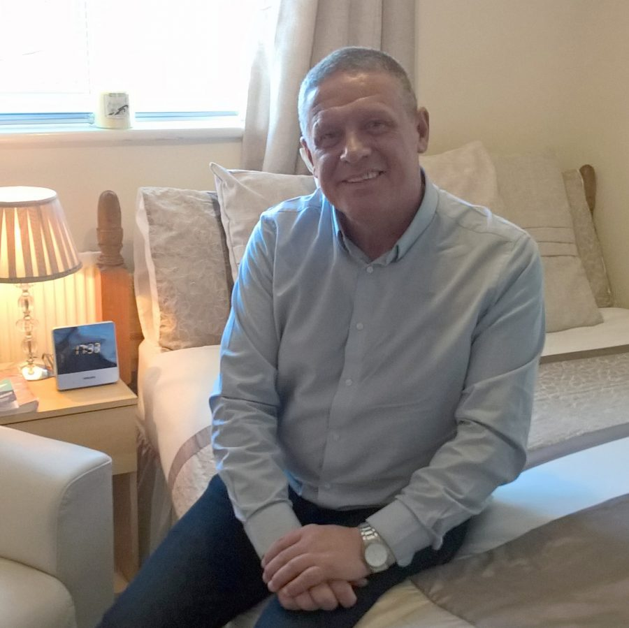 Former homeless person Clive in his new bedroom after resettlement